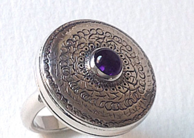 Sterling silver ring with amethyst cabochon